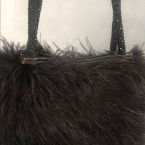 Black feather Gucci purse